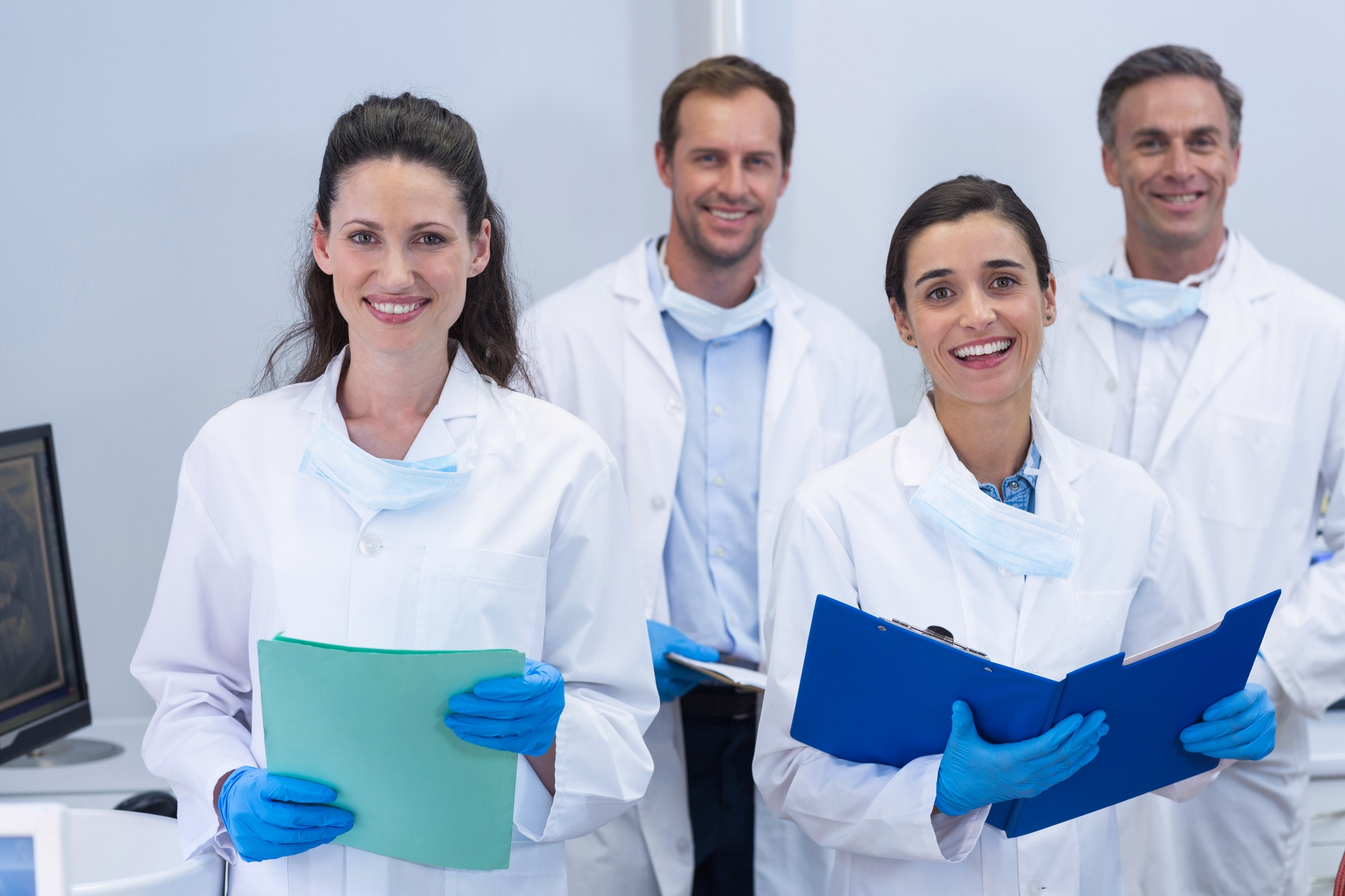 smiling-dentists-standing-in-dental-clinic.jpg